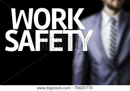 Business man with the text Work Safety in a concept image