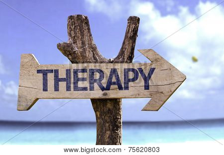 Therapy wooden sign with a beach on background