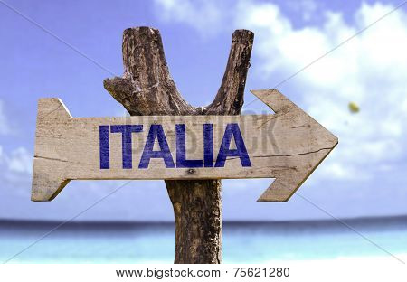Italy (In Italian) wooden sign with a beach on background