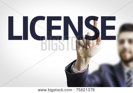 Business man pointing to transparent board with text: License