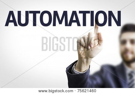 Business man pointing to transparent board with text: Automation