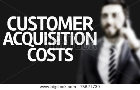 Business man with the text Customer Acquisition Costs in a concept image