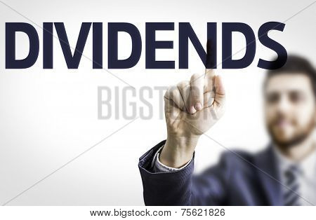 Business man pointing to transparent board with text: Dividends