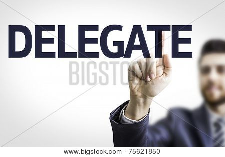Business man pointing to transparent board with text: Delegate
