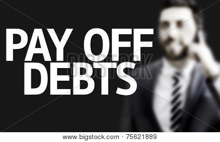 Business man with the text Pay Off Debts in a concept image
