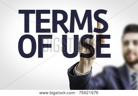 Business man pointing to transparent board with text: Terms of Use