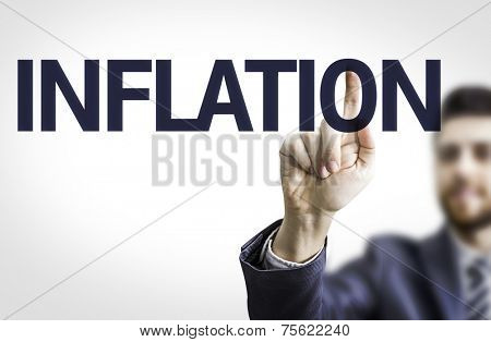 Business man pointing to transparent board with text: Inflation