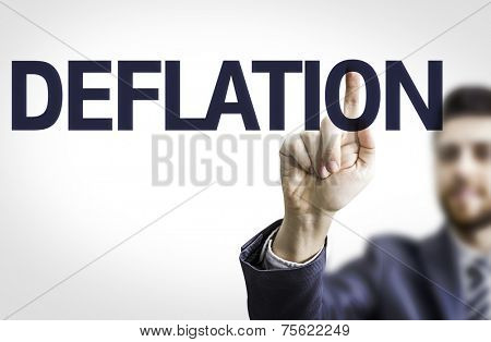 Business man pointing to transparent board with text: Deflation