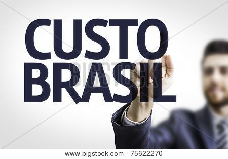 Business man pointing to transparent board with text: Brazil Cost (In Portuguese)