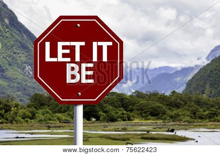 Let It Be wooden sign with a landscape background