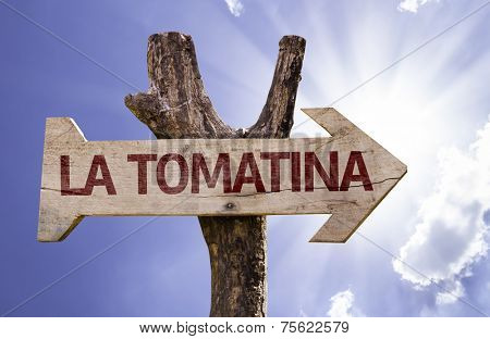 La Tomatina wooden sign on a beautiful day
