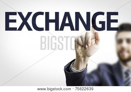 Business man pointing to transparent board with text: Exchange