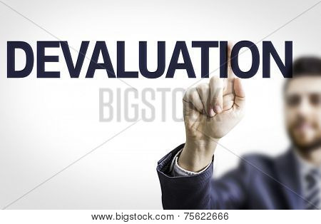 Business man pointing to transparent board with text: Devaluation