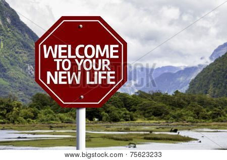 Welcome To Your New Life written on red road sign with landscape background