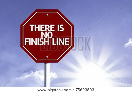 There is No Finish Line written on red road sign with a sky on background