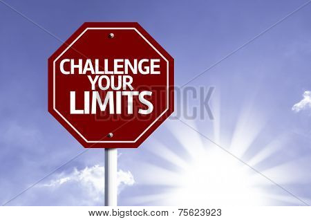 Challenge your Limits written on red road sign with a sky on background