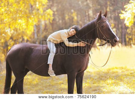 Autumn Season Happy Teenager Boy On The Horse In The Forest