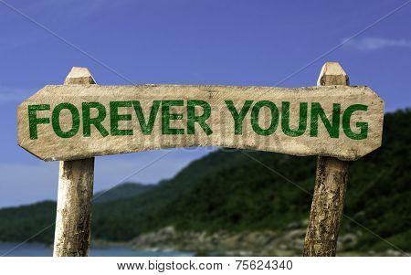 Forever Young sign with a beach on background