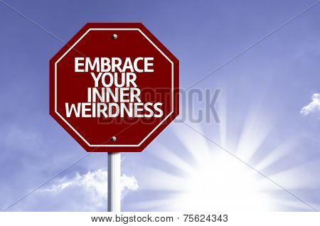 Embrace Your Inner Weirdness written on red road sign with a sky on background
