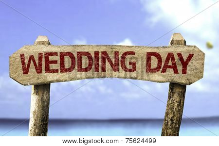 Wedding Day wooden sign with a beach on background