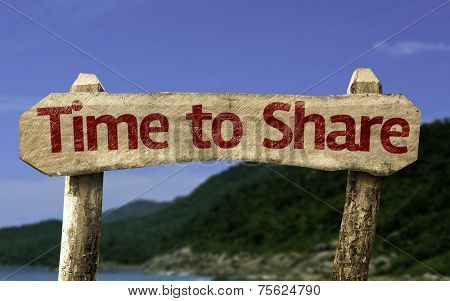 Time to Share wooden sign with a beach on background
