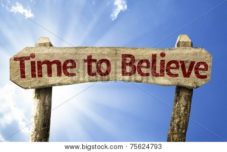 Time to Believe wooden sign on a beautiful day