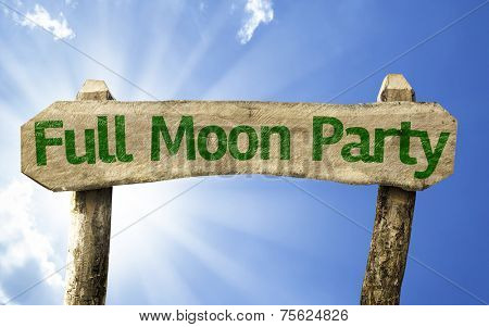 Full Moon Party wooden sign on a beautiful day