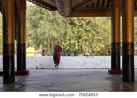 Monk walks at the Mandalay Palace