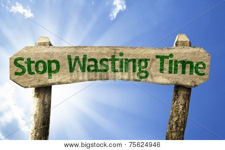 Stop Wasting Time wooden sign on a beautiful day