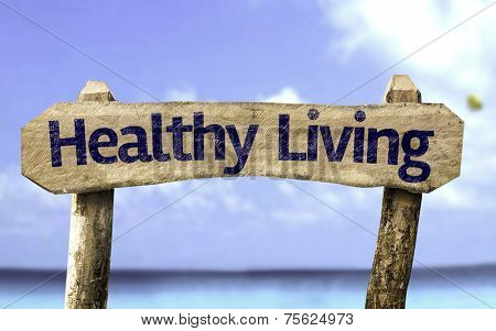 Healthy Living wooden sign with a beach on background
