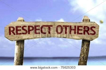 Respect Others wooden sign with a beach on background