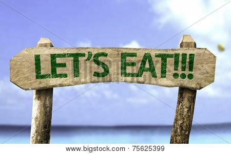 Let's Eat!! wooden sign with a beach on background