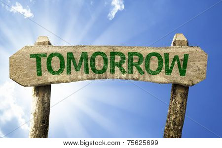 Tomorrow wooden sign on a beautiful day