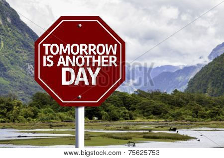 Tomorrow is Another Day written on red road sign with landscape background