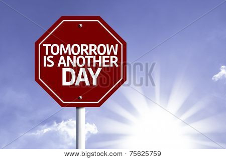 Tomorrow is Another Day written on red road sign with a sky on background