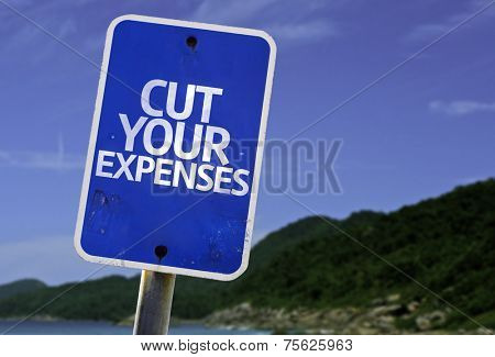 Cut Your Expenses sign with a beach on background