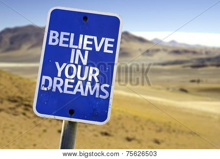 Believe in Your Dreams sign with a desert background