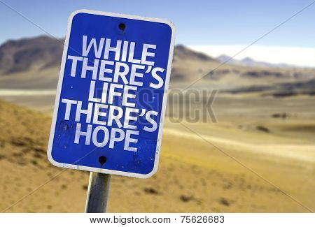 While There's Life There's Hope sign with a desert background