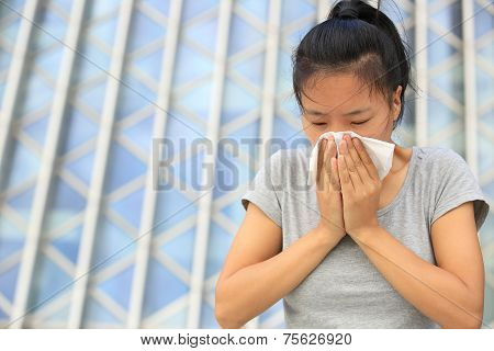 woman sneeze nose outdoor