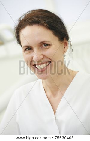 dentist orthodontist female doctor portrait at working place