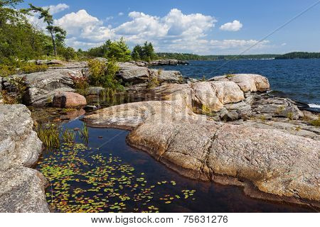 Rock formations at rocky lake shore of Georgian Bay near Parry Sound, Ontario Canada