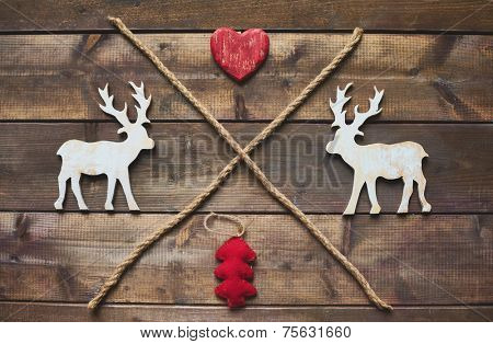 Wooden deer, heart, red fabric firtree and two ropes