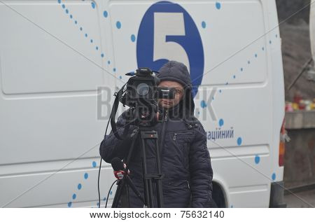 KIEV, UKRAINE - FEB 11, 2014:.TV operator of the 5-th Chanel of putsch leader Peter Poroshenko during anti-government protest.  Putsch of Junta in Kiev. February 11, 2014 Kiev, Ukraine