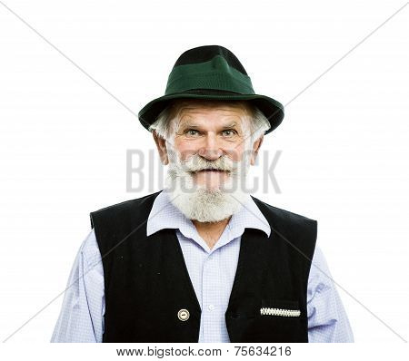 Old bavarian man in hat isolated
