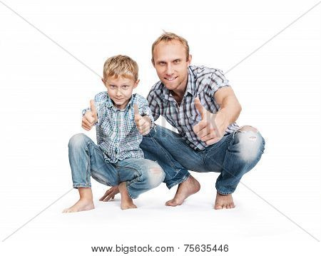 Father With Son In Blue Tattered Jeans With Great Gesture