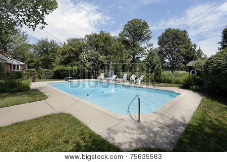 Swimming pool in suburban home with golf course view
