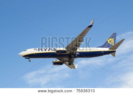 VALENCIA, SPAIN - NOVEMBER 7, 2014: A Ryanair aircraft landing at the Valencia, Spain Airport. Ryanair is the biggest low-cost airline company in the world.
