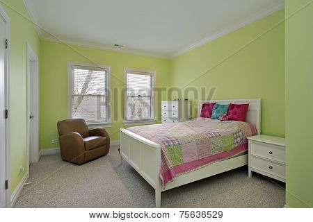 Bedroom with lime green walls and plaid bedspread