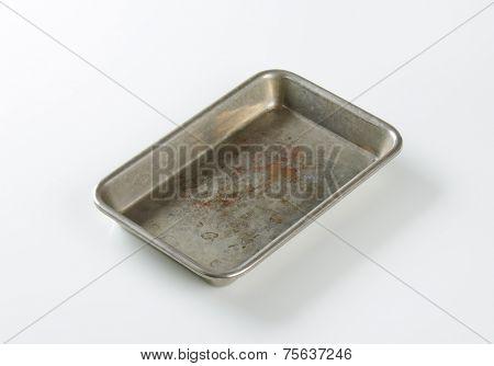 old baking tray on white background
