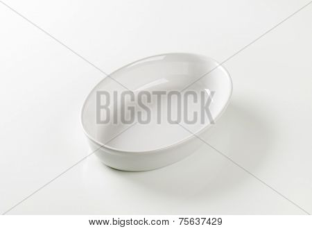 white oval bowl on white background
